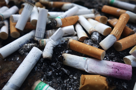 SINGAPORE- JUL 16 2018: The ashtray at the public smoking area that full of cigarette butts.