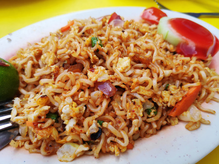 Spicy fried curry instant noodles or Malaysian style maggi goreng mamak