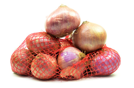 Pack of red onions isolated on white background Stock Photo