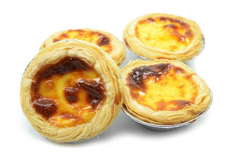 Fresh baked egg tarts or custard tarts isolated on white background