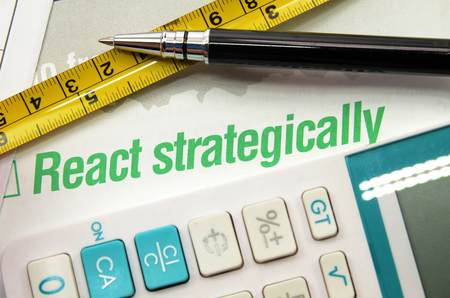 React strategically printed on a book. Business concept
