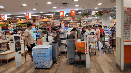 SINGAPORE- JAN 03, 2019: Customers check out and make payment in the sales counter in market in Singapore.