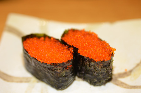 Tobiko Gunkan Sushi (Nori wrapped Flying Fish Roe Sushi) on a plate