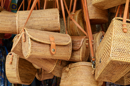 Balinese handmade rattan eco bags in a local souvenir market in Bali, Indonesia Фото со стока