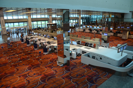 SINGAPORE, 11 Apr, 2019: Check in counters in Terminal 1 of Changi Airport in Singapore. Changi Airport is the major civilian airport for Singapore Editöryel