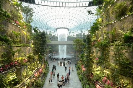 SINGAPORE, 11 Apr, 2019: The Rain Vortex, a 40m-tall indoor waterfall located inside the Jewal Changi Airport in Singapore. Jewel Changi Airport is set to open on April 17, 2019. Stock Photo - 120916245