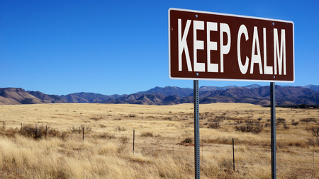 Keep calm word on road sign and blue sky