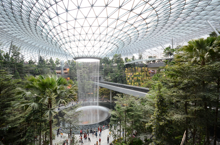 SINGAPORE, 11 Apr, 2019: The Rain Vortex, a 40m-tall indoor waterfall located inside the Jewal Changi Airport in Singapore. Jewel Changi Airport is set to open on April 17, 2019. Reklamní fotografie - 123132989
