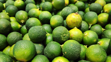 Close up of Calamansi green limes in market Reklamní fotografie