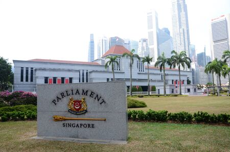 Singapore- 11 Aug, 2019: Parliament of Singapore and marble plate with city skyline in background