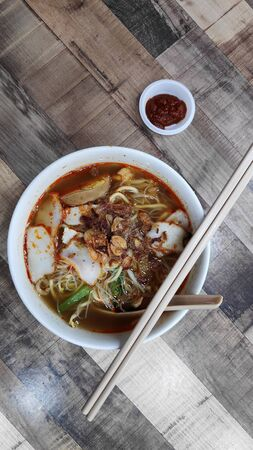 Penang popular prawn mee noodles with eggs and small shrimp served on table