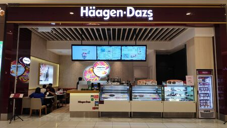 Johor Bahru, Malaysia- 28 Oct, 2019: Haagen Dazs logo in front of their local shop and restaurant in Johor Bahru. Haagen Dazs is an american ice cream manufacturer and seller Editorial