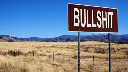 Bullshit word on road sign and blue sky