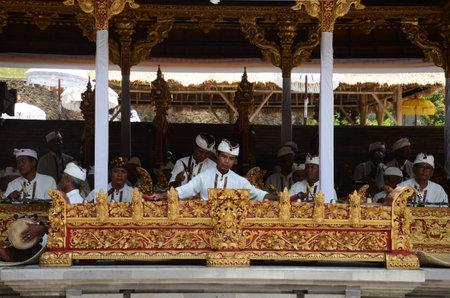 Bali, Indonesia- 18 Oct, 2019: Traditional Balinese musicians playing at music instrument gamelan