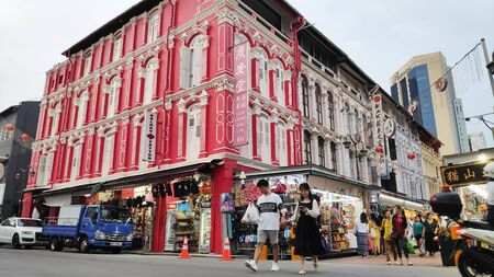 Singapore - Nov 02, 2019: Bustling street of Chinatown district in Singapore. Singapores Chinatown is a world famous bargain shopping destination. Sajtókép