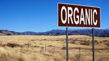 Organic brown road sign with blue sky Reklamní fotografie