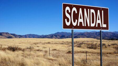 Scandal brown road sign with blue sky Reklamní fotografie