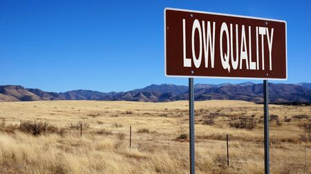 Low quality brown road sign with blue sky