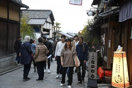 Kyoto, Japan- 24 Nov, 2019: Unidentified people stroll Sanneizaka street in Kyoto. Sanneizaka street is bustling pedestrian street on a hill lined with souvenir stalls & traditional Japanese architecture