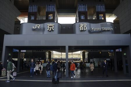 Kyoto, Japan- 24 Nov, 2019: Unidentified people walk around in front of main Central Gate of Kyoto Station in Kyoto, Japan. Kyoto Station is a Japan's second-largest station building.