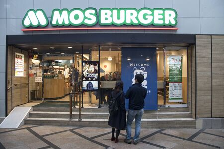 Nara, Japan- 27 Nov, 2019: Customers going to Mos burger Japanese fast food shop in Nara, Japan. Mos burger is the second-largest fast-food franchise in Japan after McDonald's.