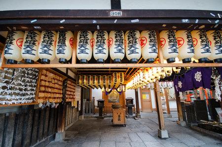 Osaka, Japan- 28 Nov, 2019: Lantern or lamp traditional lighting equipment at Hozenji Temple in Osaka, Japan. Hozenji Temple is a small but quaint temple in the warren of streets 版權商用圖片 - 137985701