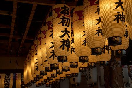 Osaka, Japan- 28 Nov, 2019: Lantern or lamp traditional lighting equipment at Hozenji Temple in Osaka, Japan. Hozenji Temple is a small but quaint temple in the warren of streets 新聞圖片