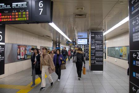 Kyoto, Japan- 27 Nov, 2019: Crowd of people walk toward the train platform inside Kyoto Station building