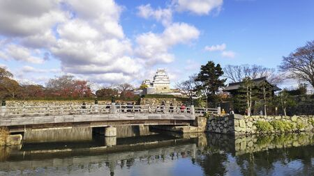 Himeji, Japan- 30 Nov, 2019: Beautiful white Himeji Castle in autumn season in Hyogo Prefecture, Japan. Himeji Castle is the largest and most visited castle in Japan