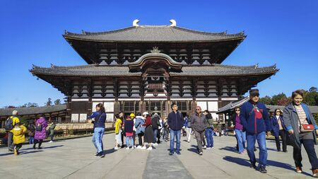 Nara, Japan- 29 Nov, 2019: People visit the Todaiji Temple in Nara, Japan. Todai-ji is Nara most popular tourist attraction and a UNESCO Heritage Site. 新聞圖片