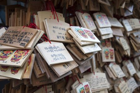 Osaka, Japan- 03 Dec, 2019: Close up wooden pray card that made from wood to use for write down something that you need or a wish at Namba Yasaka Shrine in Osaka, Japan.
