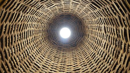 Electric bulb lighting in rattan weaving chandelier Stockfoto