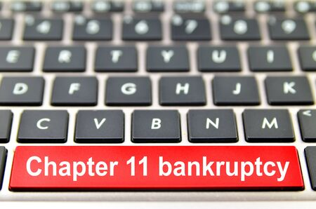 Chapter 11 bankruptcy word on computer keyboard, 3D rendering