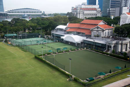 Singapore,- 8 Nov, 2020: External view of the Singapore Cricket Club building with grass lawn in front.