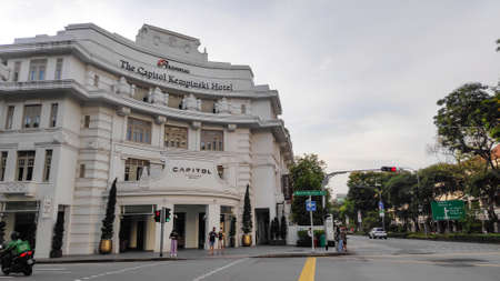 Singapore, 08 Nov, 2020: The white building with corner entrance to the Capitol Kempinski Hotel at the Downtown Core in Singapore.