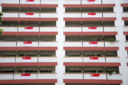 Singapore, 09 Aug, 2020: Singapore residential building suspension flag for celebration national day Editorial
