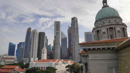 Singapore, 08 Nov, 2020: View of former Supreme Court Building and City Hall historical buildings with Singapore skyline in background Editorial