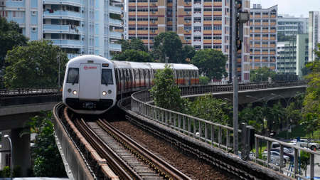 Singapore, 11 Nov, 2020: Singapore mass rapid train (MRT) approaching the train station. It is the second-oldest metro system in Southeast Asia.