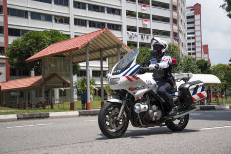 Singapore, 08 Nov, 2020: Unidentified police officer ride motorbike on Singapore National Day Mobile Column. Editorial