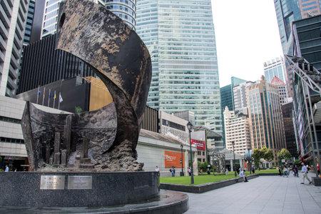Singapore- 20 Nov, 2020: Progress and Advancement sculpture at Raffles Place. The 9-tonne and 8.5m high bronze sculpture, located outside Raffles Place MRT station.