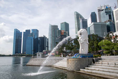 Singapore- 20 Nov, 2020: Merlion fountain in front of the Marina Bay Sands hotel in Singapore. Merlion is a imaginary creature with the head of a lion, seen a symbol of Singapore