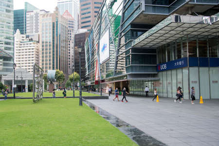 Singapore- 20 Nov, 2020: Unidentified people visit Raffles Place in Singapore.. Raffles Place is the centre of the Financial District of Singapore Editorial
