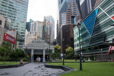 Singapore- 20 Nov, 2020: View of Raffles place subway entrance building in Singapore. Raffles Place is the centre of the Financial District of Singapore