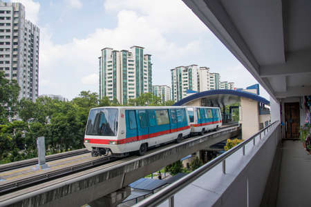 Singapore- 14 Nov, 2020: Self Driving Light Rapid Transit LRT on elevated tracks in Singapore. LRT is a localised automated guideway transit systems acting as feeder services to Mass Rapid Transit.