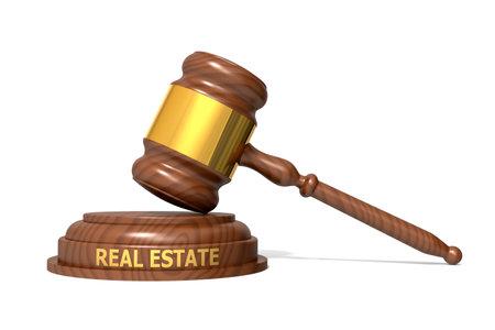 Wooden judge gavel with real estate word, 3d rendering Banco de Imagens