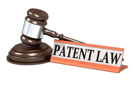 Wooden judge gavel and patent law banner, 3d rendering