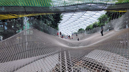 Singapore - Dec 31, 20120: Manulife Sky Nets is the attraction sports two different nets that allow visitors to take a walk or bounce from a height at Jewel's Canopy Park. Redakční