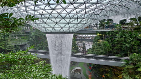 Singapore - Dec 31, 20120: General view of the tallest indoor waterfall in the world at Jewel Changi Singapore, surrounded by terraced forests. Redakční
