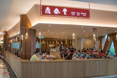 Singapore - Dec 31, 20120: Michelin star awarded Din Tai Fung store front located inside the Jewal Changi Airport in Singapore.