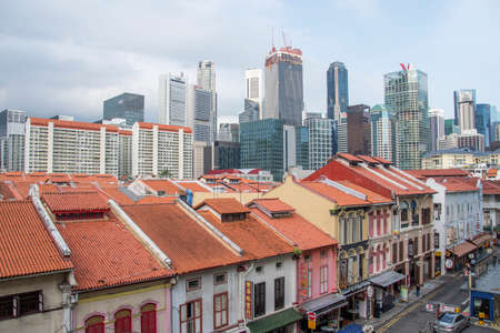 Singapore - Mar 19, 2021: Aerial view cityscape of Singapore Chinatown with downtown skyscrapers of the business financial district in the background. Redakční